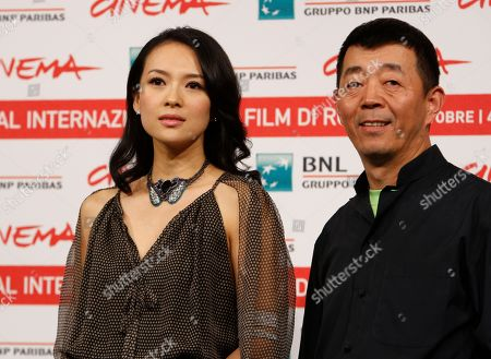 Gu Changwei, Zhang Ziyi Chinese director Gu Changwei and actress Zhang Ziyi pose during a photo call for the movie Love for Life (Zuì ài) at the Rome International Film Festival in Rome