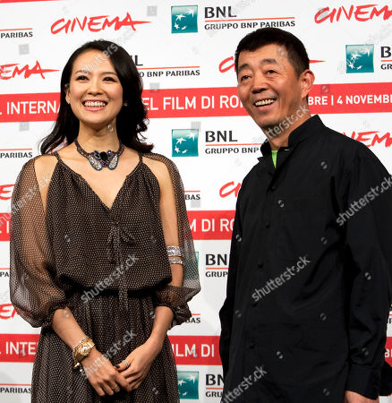 Gu Changwei, Zhang Ziyi Chinese director Gu Changwei, right, and actress Zhang Ziyi pose during a photo call for the movie Love for Life (Zuì ài) at the Rome International Film Festival in Rome
