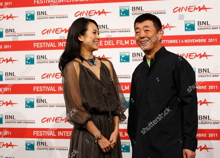 """Gu Changwei, Zhang Ziyi Chinese director Gu Changwei, right, and actress Zhang Ziyi pose during a photo call for the movie Love for Life (Zu"""" ˆi) at the Rome International Film Festival in Rome"""