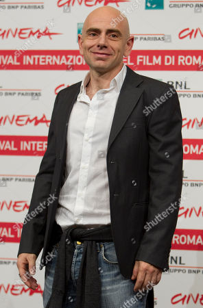 "Italian actor Rolando Ravello poses during the photo call of the movie ""Paese delle spose Infelici"", in competition at the 6th edition of the Rome International Film Festival in Rome"
