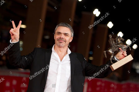 "Argentine director Sebastian Borensztein poses with the ""Marc'Aurelio"" best movie award of the 6th Rome International Film Festival, in Rome"