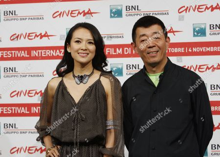 """Gu Changwei, Zhang Ziyi Chinese director Gu Changwei and actress Zhang Ziyi pose during a photocall to present their movie """"Love for Life"""" at the 6th edition of the Rome International Film Festival in Rome"""