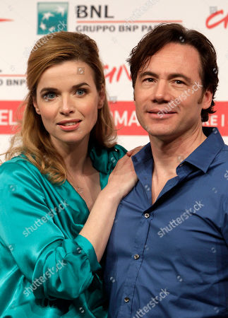 """Thekla Reuten, Michael Herbig Actress Thekla Reuten, of the Netherlands, left, poses with German actor Michael Herbig during a photocall to present the movie """"Hotel Lux"""" at the 6th edition of the Rome International Film Festival in Rome"""