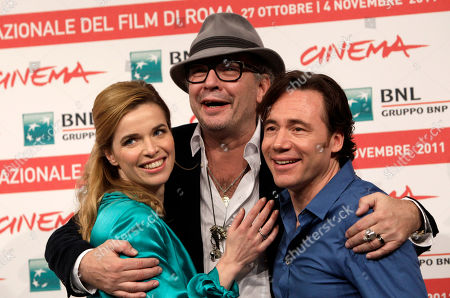"""Thekla Reuten, Leander Haussmann, Michael Herbig German director Leander Haussmann, center, poses with actress Thekla Reuten, of the Netherlands, left, and German actor Michael Herbig, to present his movie """"Hotel Lux"""" at the 6th edition of the Rome International Film Festival in Rome"""