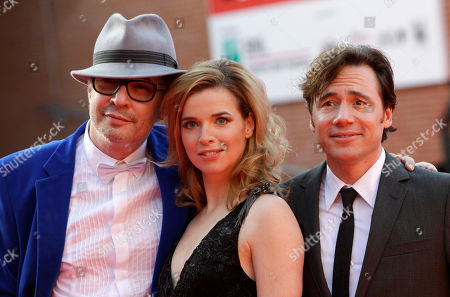 """Leander Haussmann, Thekla Reuten, Michael Herbig From left, German director Leander Haussmann, actress Thekla Reuten, of the Netherlands and actor Michael Herbig, of Germany, pose for photographers on the red carpet to present their new movie """"Hotel Lux"""" at the 6th edition of the Rome International Film Festival in Rome"""