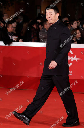 """Gu Changwei Chinese director Gu Changwei poses on the red carpet to present the movie """"Love for Life"""" at the 6th edition of the Rome International Film Festival in Rome"""