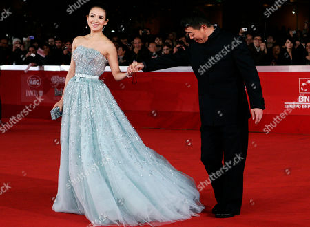 """Zhang Ziyi, Gu Changwei Chinese actress Zhang Ziyi and director Gu Changwei, right, pose on the red carpet to present the movie """"Love for Life"""" at the 6th edition of the Rome International Film Festival in Rome"""