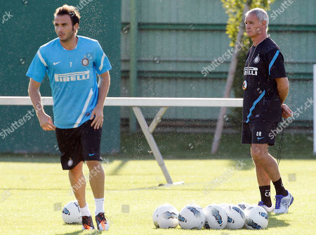 Claudio Ranieri Inter Milan new coach Claudio Ranieri, right, looks at striker Gianpaolo Pazzini during his first training session in Appiano Gentile, near Como, Italy, . Veteran coach Claudio Ranieri signed a two-year contract at Inter Milan on Thursday to become the fourth manager at the club since Jose Mourinho's departure in 2010. Gian Piero Gasperini was fired on Wednesday just five games into the season after the previous night's humiliating 3-1 loss to newly promoted Novara left Inter with one point from three Serie A games