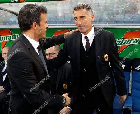 """Luis Enrique, Mauro Tassotti AS Roma coach Luis Enrique, left, and assistant coach at AC Milan Mauro Tassotti shake their hands prior to the start of a Serie A soccer match between AS Roma and Milan, in Rome's Olympic stadium, . Roma coach Luis Enrique is set to forgive Mauro Tassotti 17 years after the former Italy international broke his nose. Tassotti, now an assistant coach at AC Milan, elbowed Luis Enrique in Italy's 1994 World Cup quarterfinal victory over Spain. However, ahead of Milan's crunch clash at Rome, Luis Enrique insists it is all in the past, saying """"I know that he is sorry for what he did and I'll shake his hand."""" Luis Enrique reportedly lost a pint of blood in the incident and Tassotti was subsequently banned for eight matches by FIFA"""