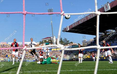 Parma's Sebastian Giovinco, center, scores past Genoa French goalkeeper Sebastien Frey and defender Luca Antonelli, left, during their Serie A soccer match at Parma's Tardini stadium, Italy, . Parma won 3-1