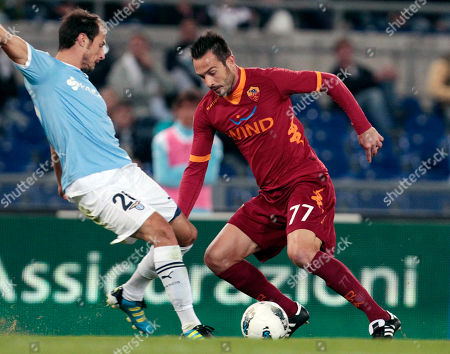 AS Roma's Marco Cassetti, right, and Lazio's Stefan Radu vie for the ball during their Serie A soccer match in Rome's Olympic stadium