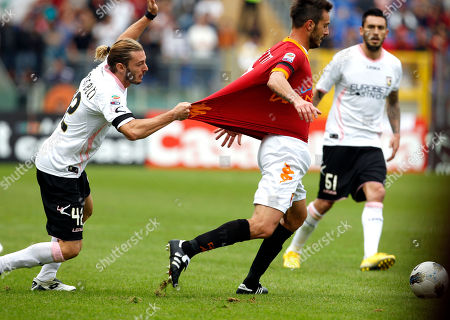 Palermo defender Federico Balzaretti pulls the jersey of AS Roma defender Marco Cassetti during the Serie A soccer match between AS Roma and Palermo at Rome's Olympic stadium
