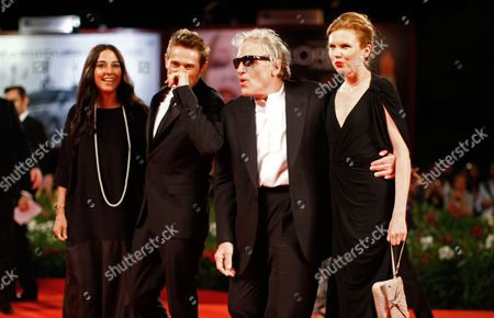 Giada Colagrande, Willem Dafoe, Abel Ferrara, Shanyn Leigh From left, Giada Colagrande, actor Willem Dafoe, director Abel Ferrara and actress Shanyn Leigh arrive for the screening of the movie 4:44 Last Day On Earth at the 68th edition of the Venice Film Festival in Venice, Italy
