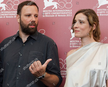 Yorgos Lanthimos, Aggeliki Papoulia Director Yorgos Lanthimos, left, and actress Aggeliki Papoulia pose during the photo call for the movie Alpis (Alps) at the 68th edition of the Venice Film Festival in Venice, Italy
