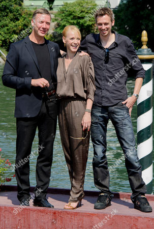 Mikael Persbrandt, Iben Hjejle, Simon Kaijser From left, Swedish actor Mikael Persbrandt, Danish actress Iben Hjejle and Simon Kaijser arrive for the press conference of their movie Stockholm East at the 68th edition of the Venice Film Festival in Venice, Italy