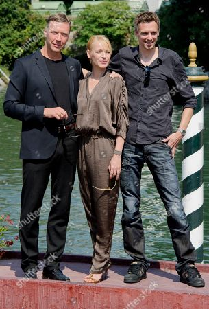 Stock Picture of Mikael Persbrandt, Iben Hjejle, Simon Kaijser From left, Swedish actor Mikael Persbrandt, Danish actress Iben Hjejle and Simon Kaijser arrive for the press conference of their movie Stockholm East at the 68th edition of the Venice Film Festival in Venice, Italy