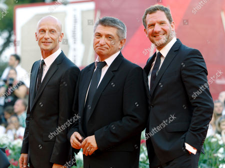 Johannes Zeiler, Aleksandr Sokurov and Anton Adasinskiy From right, Actor Johannes Zeiler, director Aleksandr Sokurov and actor Anton Adasinskiy arrive at the award ceremony of the 68th edition of the Venice Film Festival in Venice, Italy