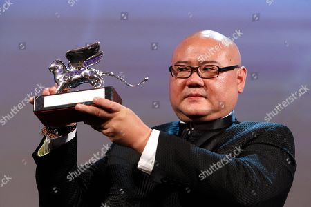 Stock Picture of Cai Shangjun Director Cai Shangjun with the Silver Lion award for Best Director for the film People Mountain people Sea during the award ceremony of the 68th edition of the Venice Film Festival in Venice, Italy