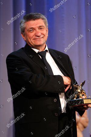 Aleksandr Sokurov Director Aleksandr Sokurov holds the Golden Lion for best film for Faust, during the award ceremony of the 68th edition of the Venice Film Festival in Venice, Italy