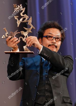 Shion Sono Japanese director Shion Sono shows the Marcello Mastroianni Prize for best emerging actor assigned to actors Shota Sometani and Fumi Nikaido for their role in the movie Himizu, during the award ceremony of the 68th edition of the Venice Film Festival in Venice, Italy