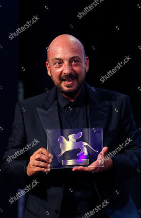Stock Picture of Emanuele Crialese Director Emanuele Crialese shows the Jury's Special Prize for the movie Terraferma during the award ceremony of the 68th edition of the Venice Film Festival in Venice, Italy