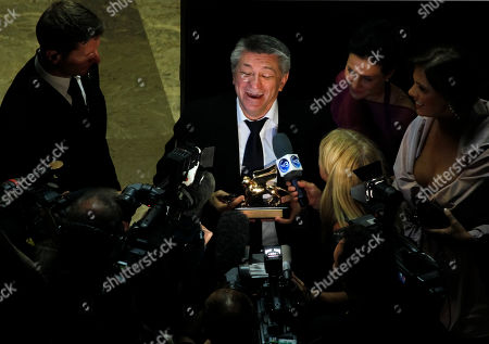 Aleksandr Sokurov Director Aleksandr Sokurov holds his Golden Lion for best film for Faust, after leaving the award ceremony of the 68th edition of the Venice Film Festival in Venice, Italy