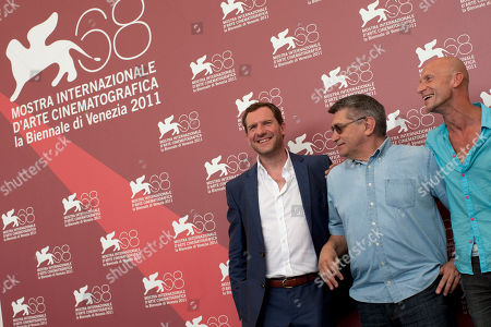 Stock Picture of Johannes Zeiler, Aleksandr Sokurov, Anton Adasinskiy Actor Johannes Zeiler, director Aleksandr Sokurov and actor Anton Adasinskiy pose at the photo call of the film Faust at the 68th edition of the Venice Film Festival in Venice, Italy