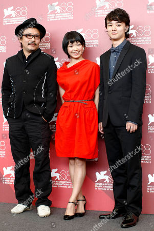 Shion Sono, Fumi Nikaidou, Shota Sometani From left, director Shion Sono, actress Fumi Nikaidou, and actor Shota Sometani pose during the photo call of the movie Himizu at the 68th edition of the Venice Film Festival in Venice, Italy