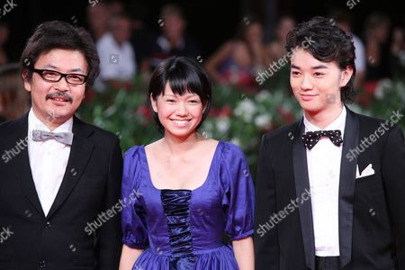 Stock Picture of Sono Sion, Shota Sometan, Fumi Nikaido Director Sono Sion, actor Shota Sometan, and actress Fumi Nikaido arrive on the red carpet for the premiere of the film 'Himizu' at the 68th edition of the Venice Film Festival in Venice, Italy
