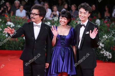 Stock Image of Sono Sion, Shota Sometan, Fumi Nikaido Director Sono Sion, actor Shota Sometan, and actress Fumi Nikaido arrive on the red carpet for the premiere of the film 'Himizu' at the 68th edition of the Venice Film Festival in Venice, Italy