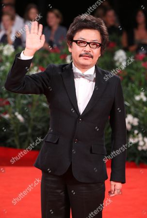 Sono Sion Director Sono Sion arrives on the red carpet for the premiere of the film Himizu at the 68th edition of the Venice Film Festival in Venice, Italy