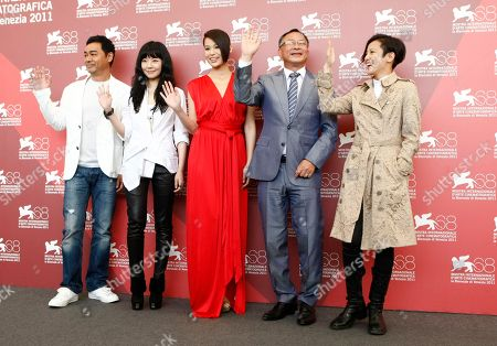 Lau Ching Wan,Stephanie Che, Myolie Wu, Johnnie To, Denise Ho From left, actor Lau Ching Wan, actresses Stephanie Che, Myolie Wu, director Johnnie To and actress Denise Ho pose during the photo call for the film Life Without Principle at the 68th edition of the Venice Film Festival in Venice, Italy
