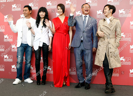 Lau Ching Wan, Stephanie Che, Myolie Wu, Johnnie To, Denise Ho From left, actor Lau Ching Wan, actresses Stephanie Che and Myolie Wu, director Johnnie To and actress Denise Ho pose during the photo call for the film Life Without Principle at the 68th edition of the Venice Film Festival in Venice, Italy