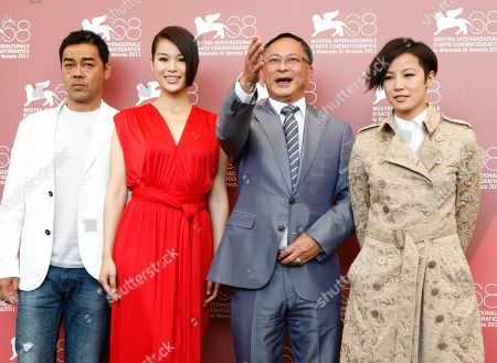 Lau Ching Wan, Myolie Wu, Johnnie To, Denise Ho From left, actor Lau Ching Wan, actress Myolie Wu, director Johnnie To and actress Denise Ho pose during the photo call for the film Life Without Principle at the 68th edition of the Venice Film Festival in Venice, Italy