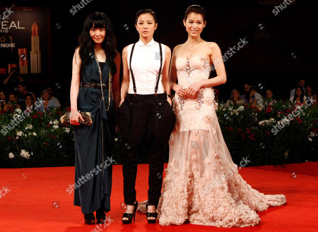 """Stephanie Che, Denise Ho, Myolie Wu From left, actresses Stephanie Che, Denise Ho and Myolie Wu arrive for the screening of the film """"Life Without Principle"""" at the 68th edition of the Venice Film Festival in Venice, Italy"""