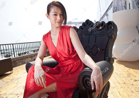 Stock Picture of Myolie Wu Actress Myolie Wu poses for portraits after interviews for the film Life Without Principle at the 68th edition of the Venice Film Festival in Venice, Italy