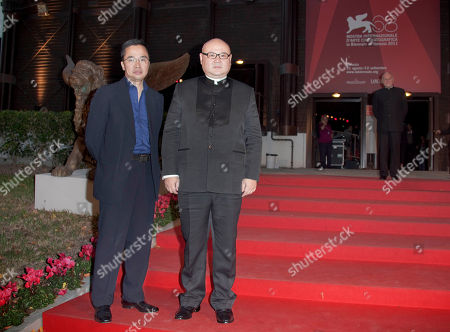 Cai Shangjun Director Cai Shangjun, right, and an unidentified guest arrive for the screening of his movie People Mountain People Sea at the 68th edition of the Venice Film Festival in Venice, Italy