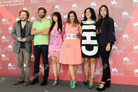 Mathieu Amalric, Vincent Paronnaud, Maria de Medeiros, Rona Hartner, Marjane Satrapi, Golshifteh Farahani From left, French actor Mathieu Amalric, Vincent Paronnaud, Portuguese actress Maria de Medeiros, Romanian actress Rona Hartner, Iranian writer Marjane Satrapi and Iranian actress Golshifteh Farahani pose at the photo call of the film Poulet Aux Prunes at the 68th edition of the Venice Film Festival in Venice, Italy