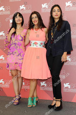 Stock Image of Maria de Medeiros, Rona Hartner, Golshifteh Farahani From left, Portuguese actress Maria de Medeiros, Romanian actress Rona Hartner and Iranian actress Golshifteh Farahani pose at the photo call of the film Poulet Aux Prunes at the 68th edition of the Venice Film Festival in Venice, Italy