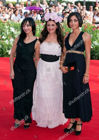 Maria De Medeiros, Rona Hartner, Golshifteh Farahani From left, actresses Maria De Medeiros, Rona Hartner, and Golshifteh Farahani arrive for the screening of the movie Poulet Aux Prunes at the 68th edition of the Venice Film Festival in Venice, Italy