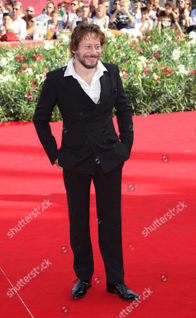Mathieu Almaric French actor Mathieu Almaric arrives for the screening of the movie Poulet Aux Prunes at the 68th edition of the Venice Film Festival in Venice, Italy