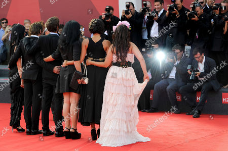 """Maria de Medeiros, Mathieu Amalric, Vincent Paronnaud, Marjane Satrapi, Golshifteh Farahani, Rona Hartner From left, Portuguese actress Maria de Medeiros, French actor Mathieu Amalric, Vincent Paronnaud, Iranian writer Marjane Satrapi, Iranian actress Golshifteh Farahani, and Romanian actress Rona Hartner, arrive for the premiere of """"Poulet Aux Prunes"""" at the 68th edition of the Venice Film Festival in Venice, Italy"""