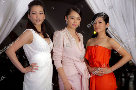 Stock Image of Landy Wen, Vivian Hsu, Lo Mei Ling Acresses, from left, Landy Wen, Vivian Hsu, and Lo Mei Ling pose at the 68th edition of the Venice Film Festival in Venice, Italy