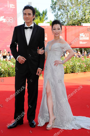Landy Wen Actress Landy Wen, right, arrives with an unidentified guest for the premiere of the film 'Seediq Bale (Warriors of the Rainbow) at the 68th edition of the Venice Film Festival in Venice, Italy