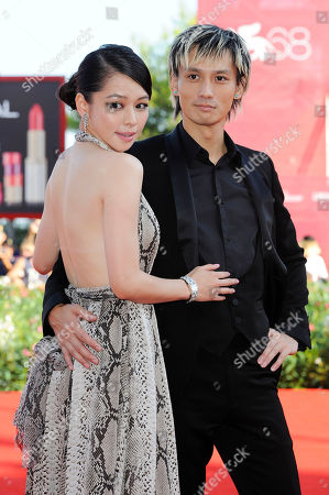 Vivian Hsu, Ando Masanobu From left actress Vivian Hsu and actor Ando Masanobu arrive for the premiere of the film 'Seediq Bale (Warriors of the Rainbow) at the 68th edition of the Venice Film Festival in Venice, Italy
