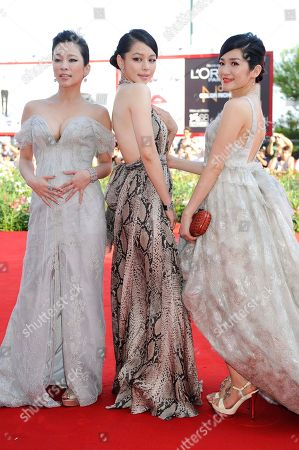 Stock Photo of Landy Wen, Vivian Hsu, Lo Mei-Ling From left, actresses Landy Wen, Vivian Hsu and Lo Mei-Ling arrive for the film 'Seediq Bale (Warriors of the Rainbow) at the 68th edition of the Venice Film Festival in Venice, Italy