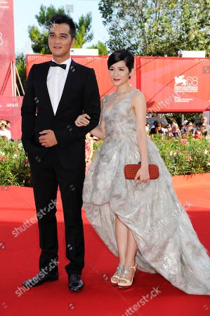 Stock Image of Umin Boya, Lo Mei-ling From left actor Umin Boya and actress Lo Mei-ling arrive for the premiere of the film 'Seediq Bale (Warriors of the Rainbow) at the 68th edition of the Venice Film Festival in Venice, Italy