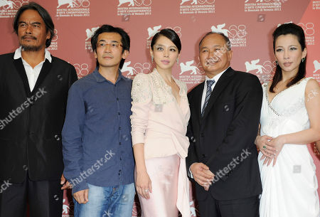 Stock Picture of Lin Ching Tai, Vivian Hsu, John Woo, Landy Wen, Wei Te Sheng From left actor Lin Ching Tai, director Wei Te Sheng, actress Vivian Hsu, producer John Woo and actress Landy Wen pose at the photo call for the film 'Seediq Bale (Warriors of the Rainbow)at the 68th edition of the Venice Film Festival in Venice, Italy