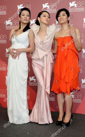 Stock Image of Landy Wen, Vivian Hsu and Lo Mei-Ling From left actor actresses Landy Wen, Vivian Hsu and Lo Mei-Ling pose at the photo call for the film 'Seediq Bale (Warriors of the Rainbow)at the 68th edition of the Venice Film Festival in Venice, Italy
