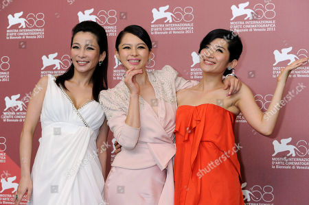 Stock Photo of Landy Wen, Vivian Hsu and Lo Mei-Ling From left actor actresses Landy Wen, Vivian Hsu and Lo Mei-Ling pose at the photo call for the film 'Seediq Bale (Warriors of the Rainbow)at the 68th edition of the Venice Film Festival in Venice, Italy